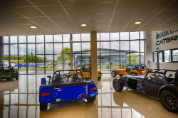 Caterham showroom with porcelain tiles, suspended ceiling, full height windows