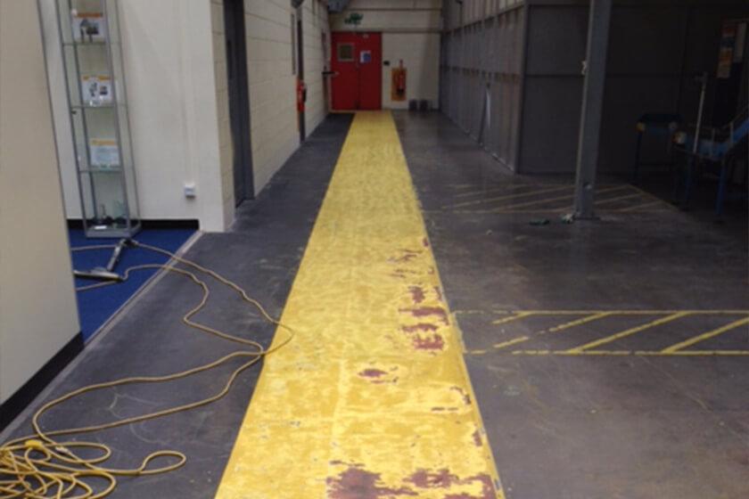 Warehouse pedestrian walkway in need of repainting
