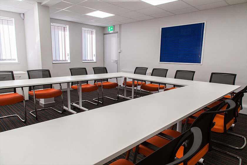 Thermaset's refurbished meeting room, featuring corporate colours