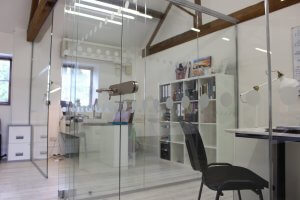 Glass partitioning in barn conversion office