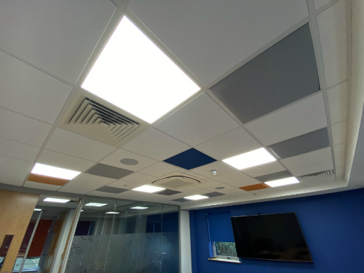 Coloured acoustic panels in suspended ceiling