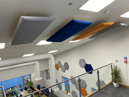 Sound absorbing ceiling and wall acoustic panels in open plan office